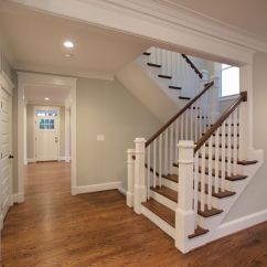 Living Room Paint Colors With Oak Trim Design Ideas Photos The Beautiful U-shaped Stair Has Hardwood Treads And ...
