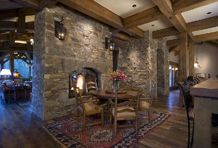 pictures of living rooms with stone fireplaces florida room colorado residence 2 double sided fireplace between the ...
