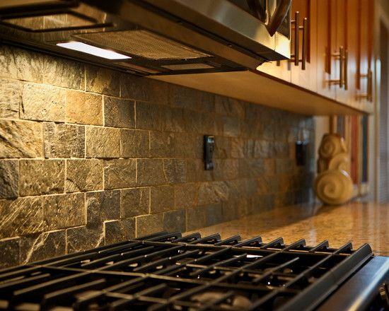 rustic kitchen with stone backsplash A textured stone backsplash is sure to give your kitchen a