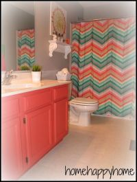 Coral and Turquoise bathroom. I love the chevron shower ...