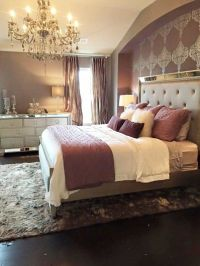 A DIY purple stenciled accent wall in a bedroom using the ...