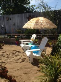 Our Backyard beach...cover umbrella with fake grass ...