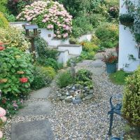 An easy design idea is to replace grass with gravel or ...