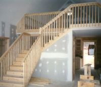 Rustic style stairway with balusters and handrails out of