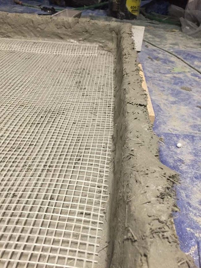 He packed in glass fiber concrete and mesh by hand to