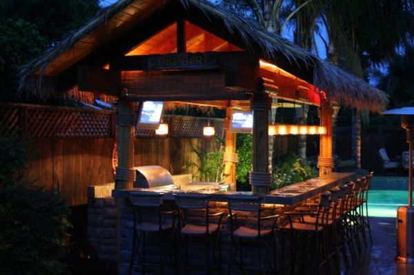 tiki bar with natural poles paneling