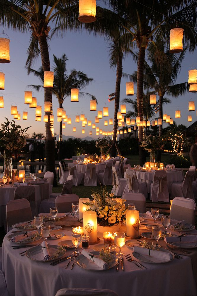 Floating lanterns over a sunset reception | Santana Photography