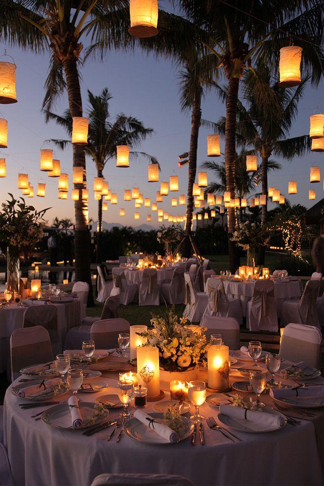 Floating lanterns over a sunset reception | Santana Photography