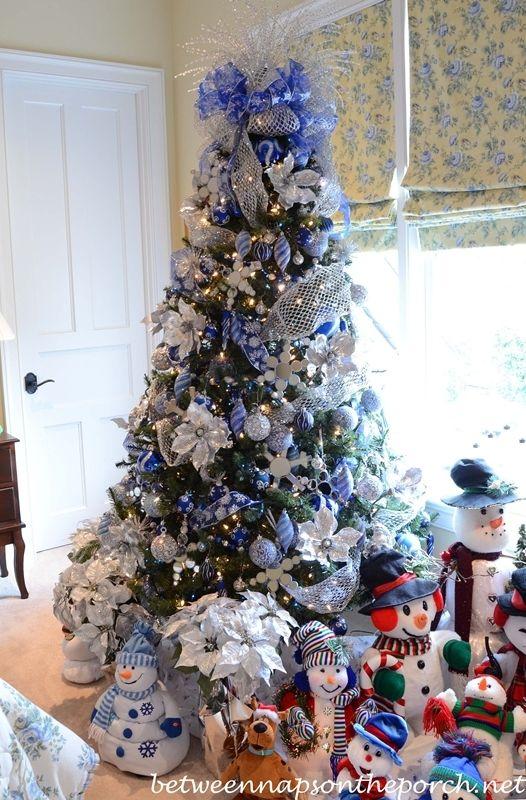 Temtica de decoracin con el mueco de nieve en colores azul y plateado. #DecoracionNavidad