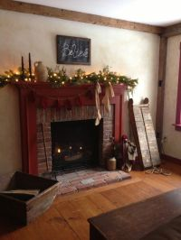 Gas fireplace with colonial mantle style decorated for a ...