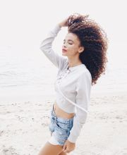 windy curls. hair. hair blowing