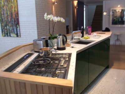 view of island with downdraft extractor & flush fit Miele ...