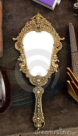 Vintage handheld mirror by Viktorfischer via Dreamstime