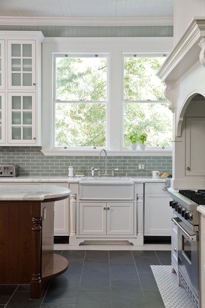 Kitchen with white cabinets aqua beadboard walls and aqua