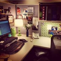 Cubicle decor - I like the desk lamp, plant, wallpaper ...