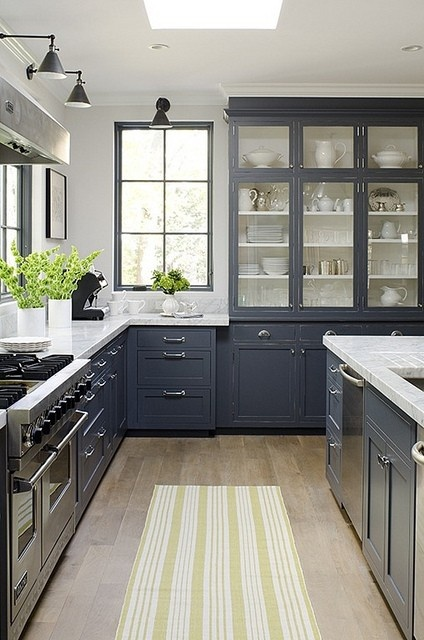 Navy cabinets and white countertops  Basement Ideas
