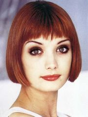 chin-length auburn bob with bangs