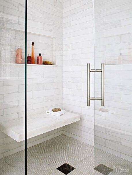 Instead of installing a weighty shower bench in your walk-in shower, opt for a sleek floating seat that doesn't clutter up the interior. Appearing to seamlessly jut out from the rear shower wall, this thick marble ledge tiptoes into view beneath a toiletry niche that mirrors the shower seat's horizontal silhouette./: