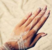 white henna hand tattoo design