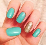teal nails with gold accent