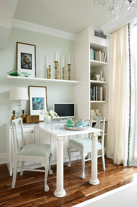 Gold Accents! Brass candlestick collection; white painted built-ins, fresh blue-green gray on the walls. Sarah Richardson