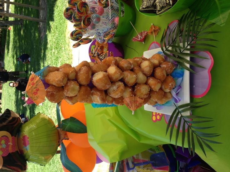 Donut hole tower for summer luau birthday party Dessert table  Kids party ideas  Pinterest