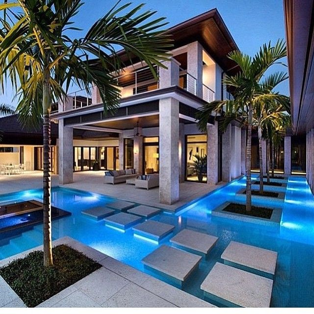 Modern house surrounded by a pool  Home ideas  Pinterest