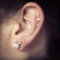 triple cartilage and double earlobe piercing