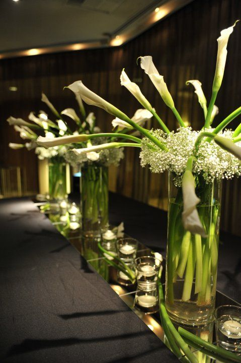 Calla Lilies With Babys Breath Centerpieces On Top Of