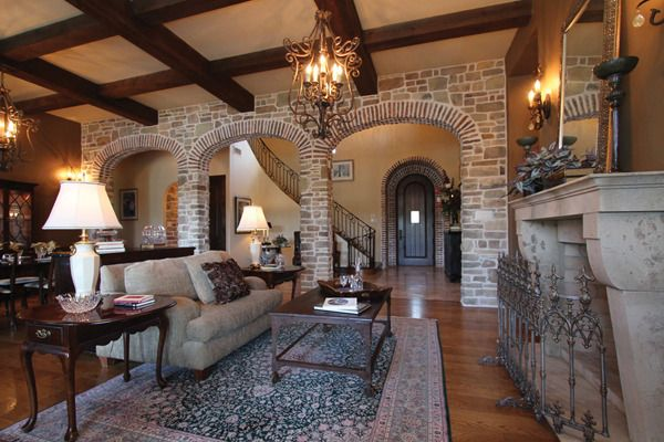 The Living Room Has Hardwood Floors A Wood Burning Fireplace Decorative Lighting And Stone