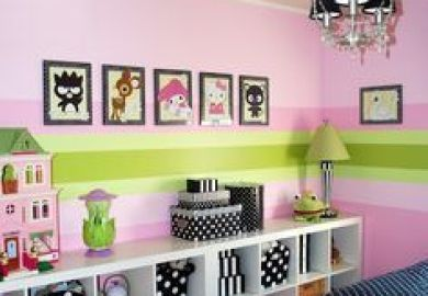 Girls Bedroom With Open Storage Shelves And Polka Dot Accents