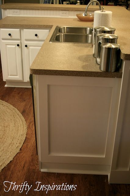 Add 1x4 moulding to oven cabinet  side of fridge  maybe