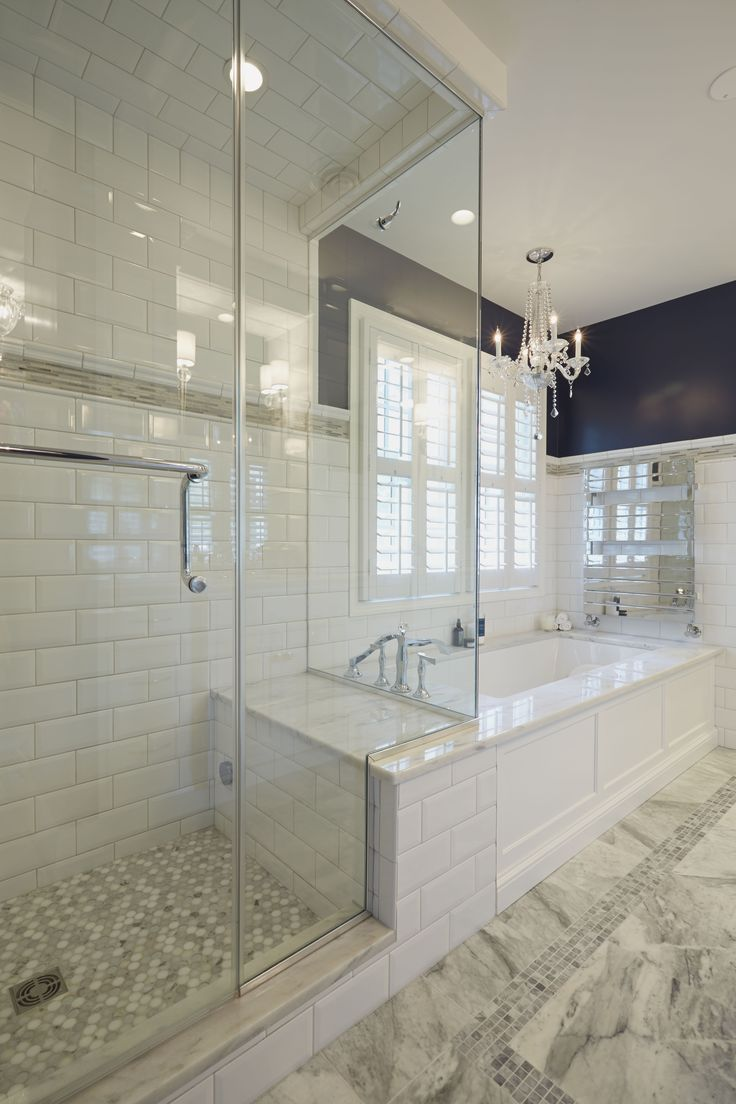 Glass Enclosed Shower With Bench Connected To The Platform