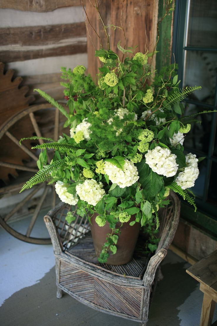 Fern Wedding in the Mountains Buffett table centerpiece with ferns white hydrangea and