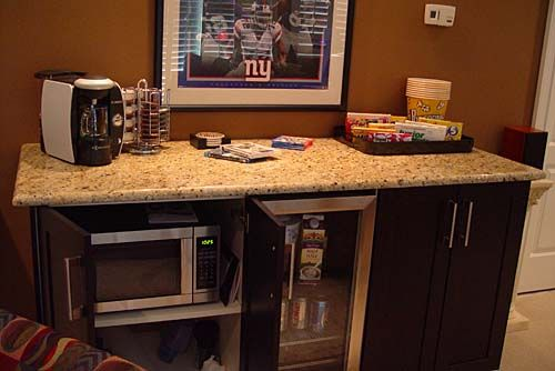 Microwave for movie popcorn Cabinet on right conceals a