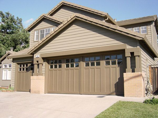 Clopay Coachman Collection carriage house garage doors Design 43 with SQ23 windows painted to