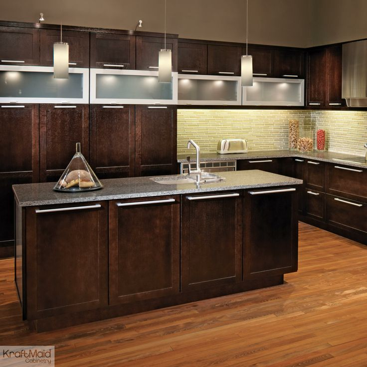 Peppercorn on Quartersawn Oak combines with stainless steel decorative hardware to create a