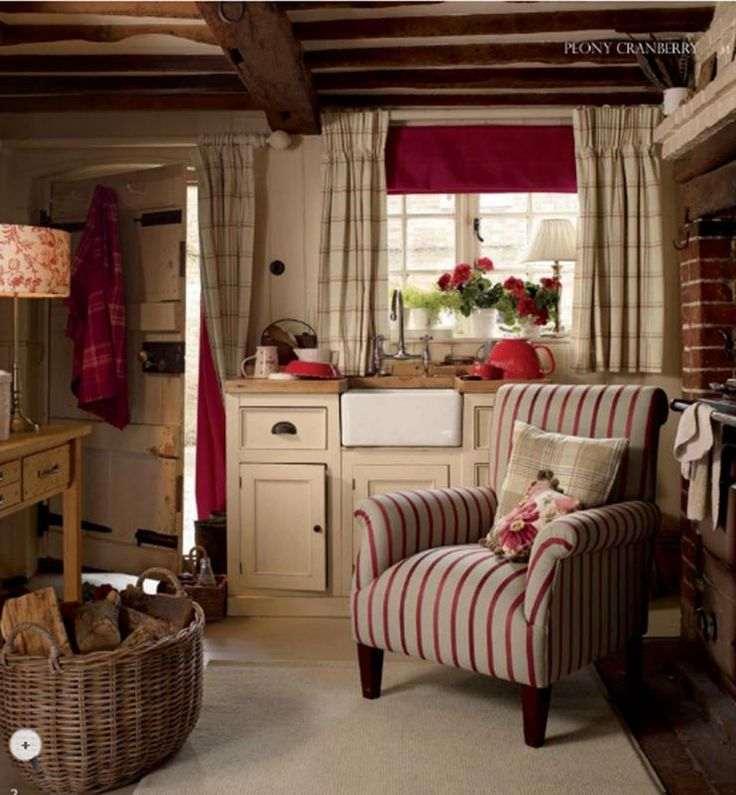 cosy cottage kitchen with armchair by the range