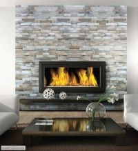 Fireplace inspiration. Ledgestone wall, floating mantel ...