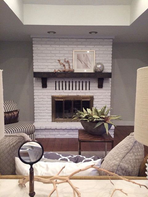Painted brick fireplace wood mantle and brass gate  Living Room  Pinterest  Grey walls Wall