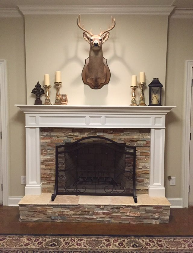 Deer stone fireplace mantle stained concrete floors basement traditional mantle stacked