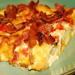 Charleston Breakfast Casserole | An easy, crowd-pleasing breakfast casserole with a crouton and Cheddar cheese base. This recipe calls for bell pepper and bacon, but you can have fun playing with the ingredients to dress it up or down, depending on the occasion.: