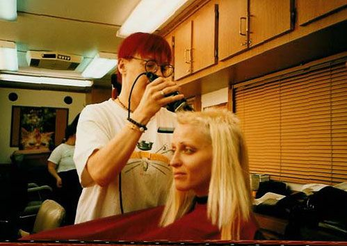 Lori Petty receiving buzz haircut  for Tank Girl Film