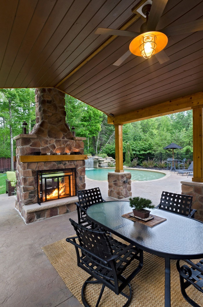 A Two Sided Stone Fireplace Can Be Accessed Both Inside