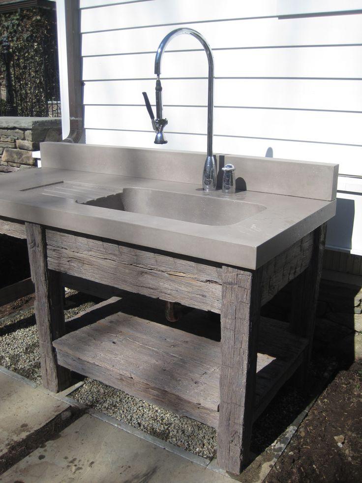 Reclaimed wood vanity base and concrete bathroom sink by