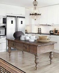 This antique island in the kitchen adds a unique rustic ...