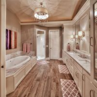 Master bathroom: hardwood floors, large tub, his and her ...