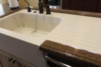 Custom made Corian farm sink with drainboard in a Hanstone ...