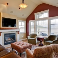 love the windows, vaulted ceilings and TV placement over ...