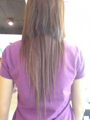 layered shaped haircut with bangs